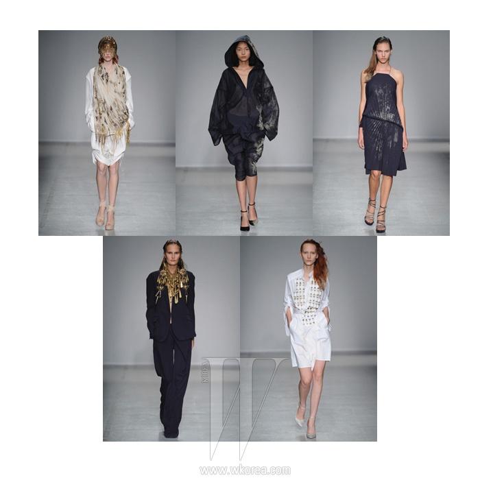 파리에서 열린 2014 S/S 컬렉션. 사막에서 온 모던한 여인처럼 여유로운 실루엣의 옷에 비즈처럼 장식된 모래알들이 서정적인 무드를 전한다. 볼드한 황금빛 주얼리는 런던 주얼리 디자이너 비키 사지와 협업한 것.