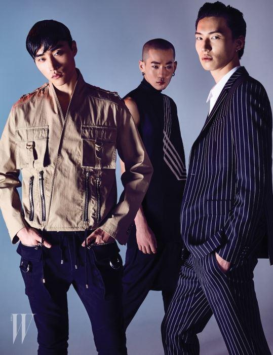 왼쪽부터 | 류완규가 입은 포켓 장식의 밀리터리 재킷, 저지 팬츠는 발망 제품. 조환이 입은 사선 그래픽의 톱과 팬츠는 릭 오웬스 제품. 김병수가 입은 핀스트라이프 슈트는 지방시 바이 리카르도 티시 제품.