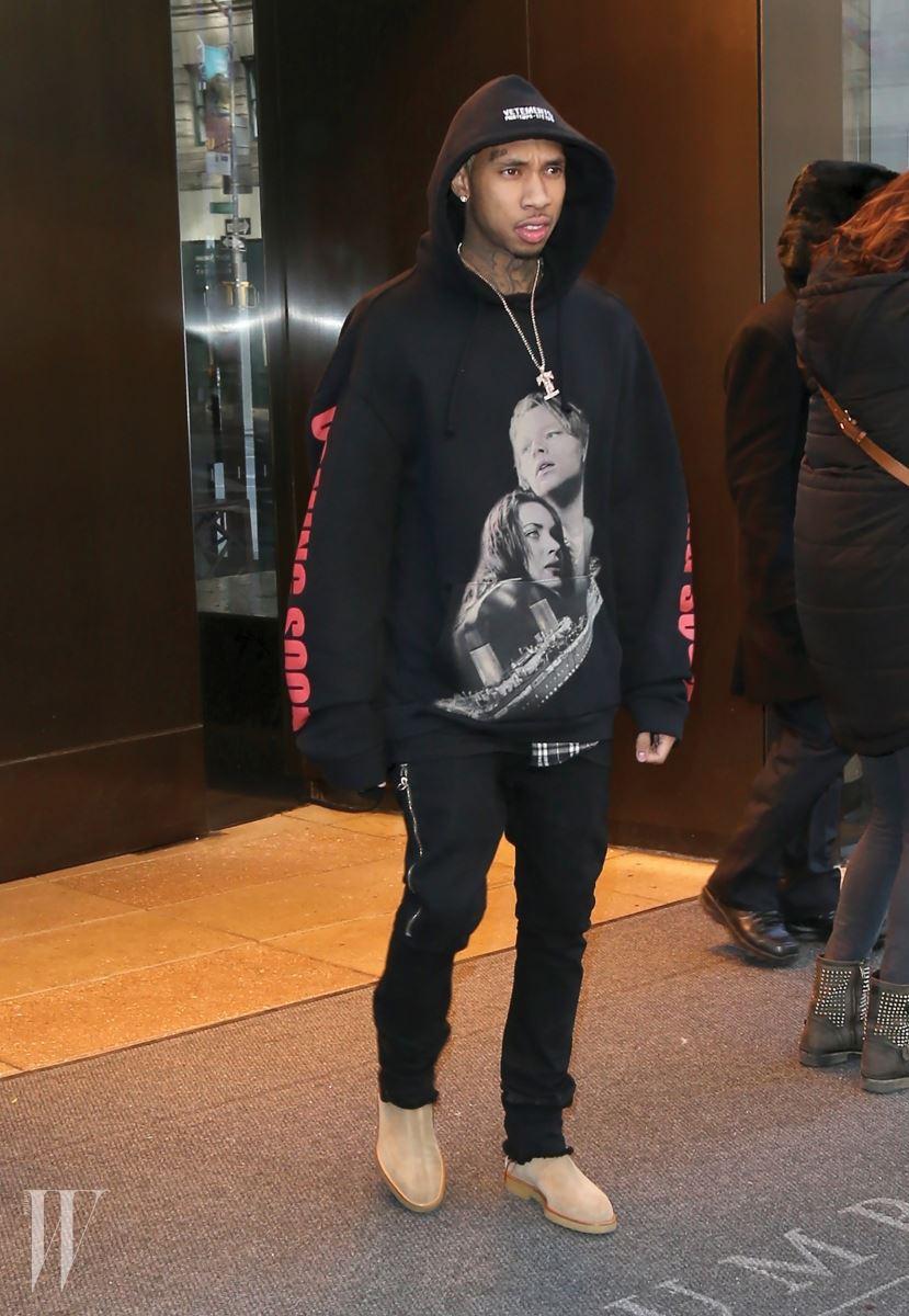Tyga steps out in New York City wearing a black hoodie with an image of Jack and Rose from 'Titanic'. Pictured: Tyga Ref: SPL1226854  130216   Picture by: Splash News Splash News and Pictures Los Angeles:310-821-2666 New York:	212-619-2666 London:	870-934-2666 photodesk@splashnews.com