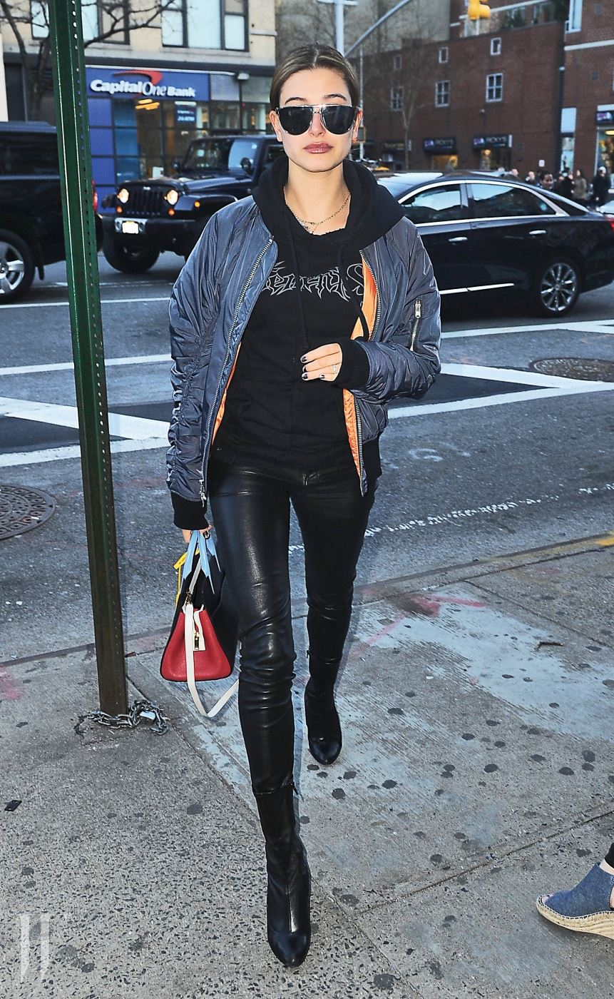 Hailey Baldwin rocks a Vetements sweater as she heads out to CitiPups with Kendall Jenner in New York City. Pictured: Hailey Baldwin Ref: SPL1254121  290316   Picture by: Splash News Splash News and Pictures Los Angeles:310-821-2666 New York:212-619-2666 London:870-934-2666 photodesk@splashnews.com