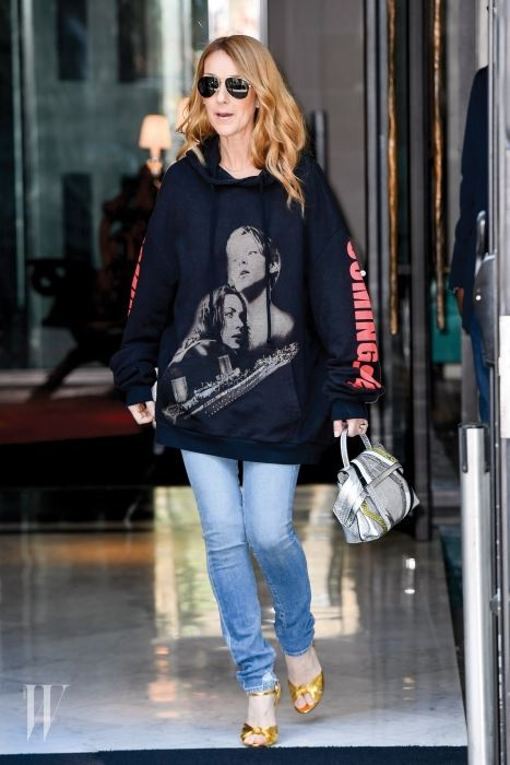Celine Dion  is wearing a large sweaters with Di Caprio and Kate Winslet pictures in effigy of Titanic movie  Pecquenard / KCS PRESSE Ref: SPL1315342  080716   Picture by: KCS Presse / Splash News Splash News and Pictures Los Angeles:310-821-2666 New York:212-619-2666 London:870-934-2666 photodesk@splashnews.com