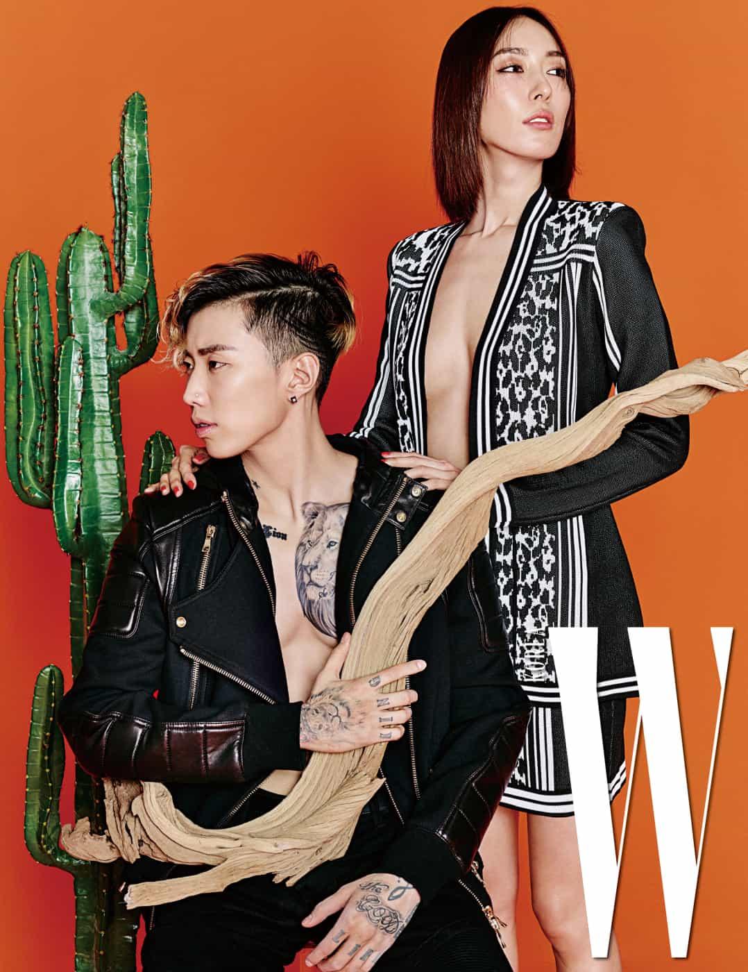 박재범이 착용한 가죽이 믹스된 후드 장식 바이커 재킷과 팬츠, 지현정이 착용한 레오퍼드 패턴 톱과 미니스커트는 모두 Balmain 제품.