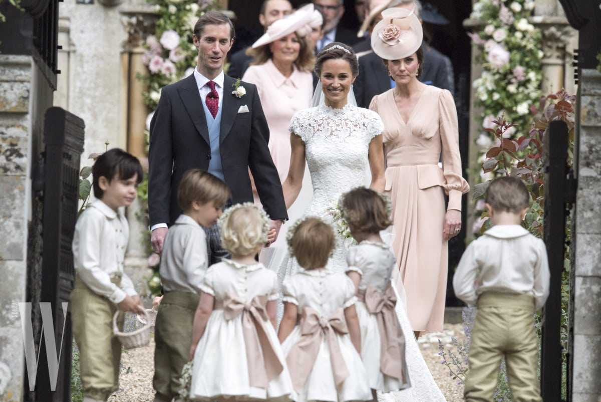 ENGLEFIELD GREEN, ENGLAND - MAY 20: Pippa Middleton and James Matthews smile as they are joined by Catherine, Duchess of Cambridge, right, after their wedding at St Mark's Church onMay 20, 2017 in Englefield, England(Photo by Arthur Edwards - WPA Pool/Getty Images)