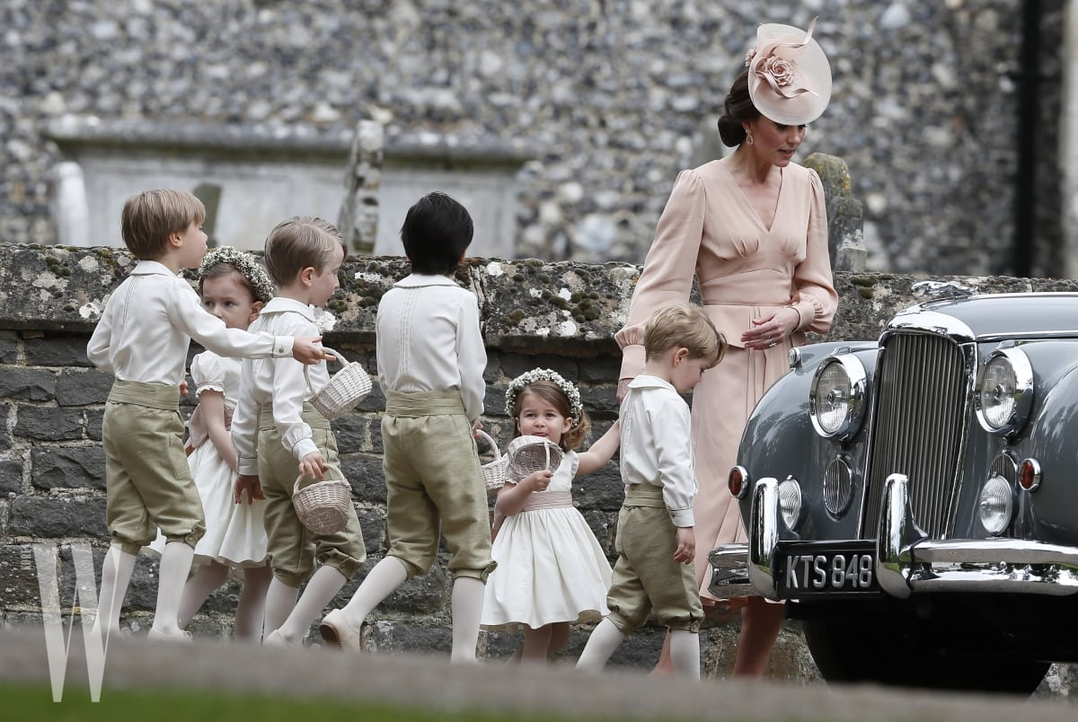 ENGLEFIELD, ENGLAND - MAY 20:  Catherine, Duchess of Cambridge, right, walks with the flower boys and girls, including Prince George, second right, and Princess Charlotte after the wedding of Pippa Middleton and James Matthews at St Mark's Church ion May 20, 2017 in in Englefield, England.  Middleton, the sister of Catherine, Duchess of Cambridge married hedge fund manager James Matthews in a ceremony Saturday where her niece and nephew Prince George and Princess Charlotte was in the wedding party, along with sister Kate and princes Harry and William. (Photo by Kirsty Wigglesworth - Pool/Getty Images)