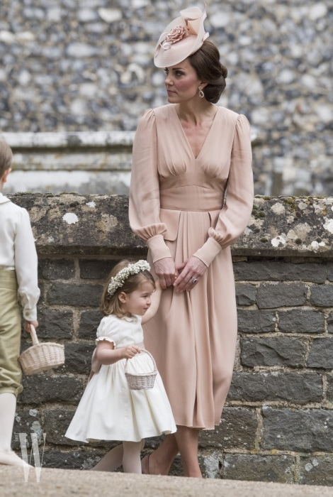 ENGLEFIELD GREEN, ENGLAND - MAY 20: Catherine, Duchess of Cambridge speaks to Princess Charlotte after the wedding of Pippa Middleton and James Matthews at St Mark's Church on May 20, 2017 in in Englefield, England. (Photo by Arthur Edwards - WPA Pool/Getty Images)
