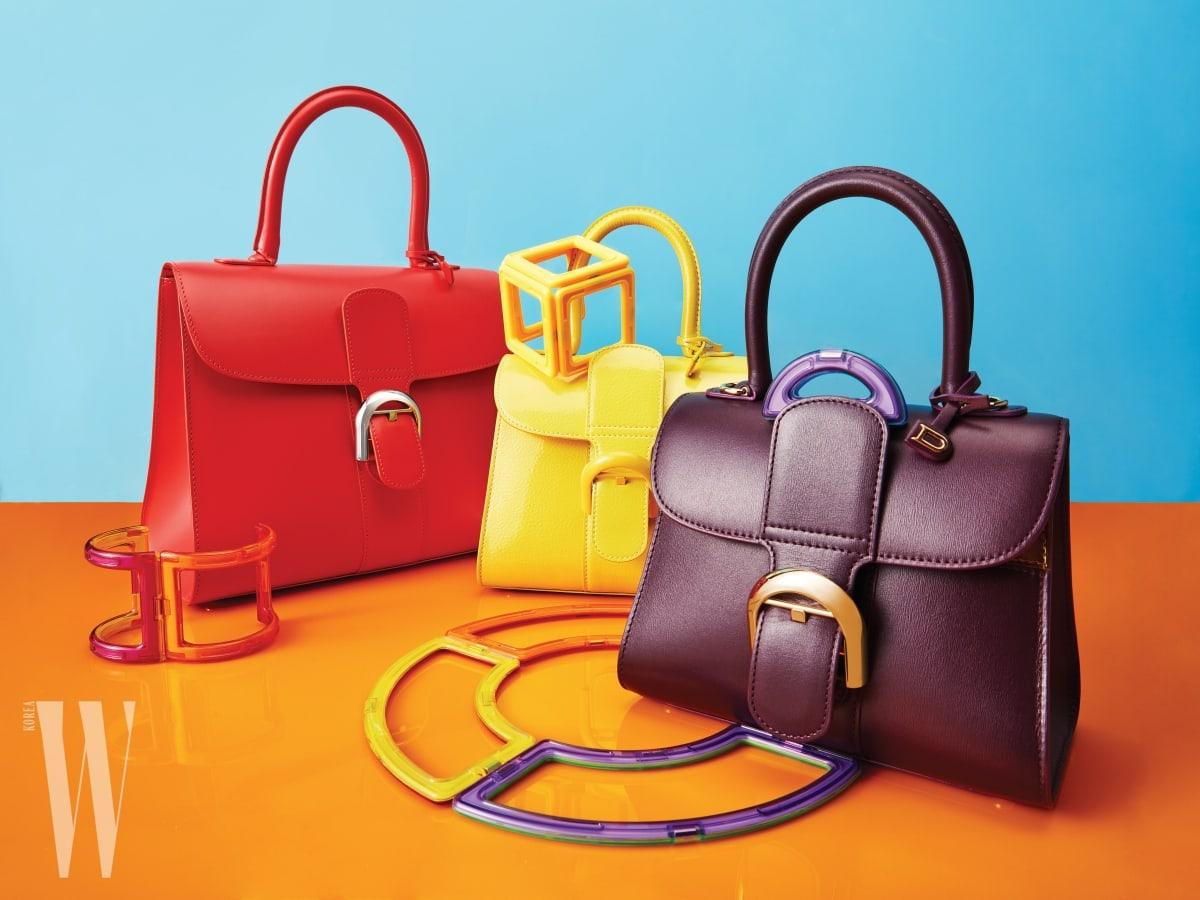 간결한 디자인과 생동감 넘치는 컬러가 인상적인 백은 델보 제품. 뒤쪽부터 7백20만원, 4백70만원, 5백40만원.