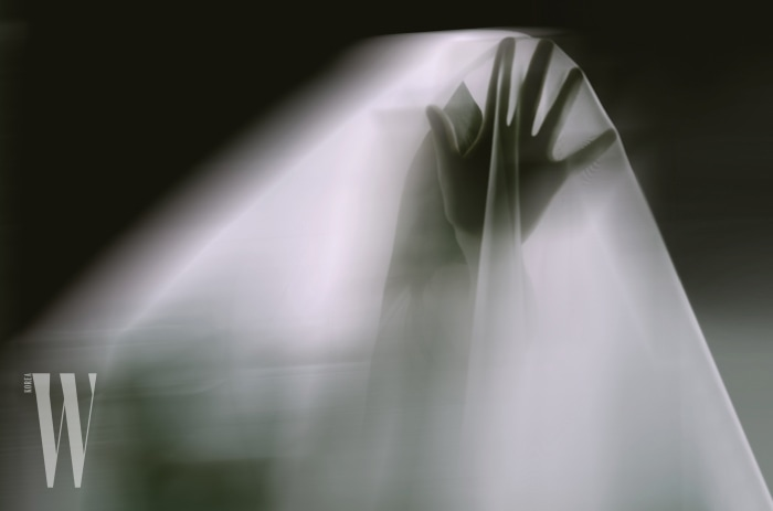 A ghostly apparition of a woman isolated on a black background
