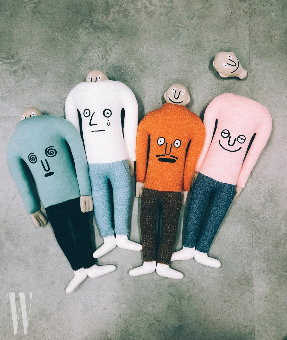 다양한 기분을 나타내는 장 줄리앙의 얼굴 시리즈를 입은 누누 컬렉션의 인형.
