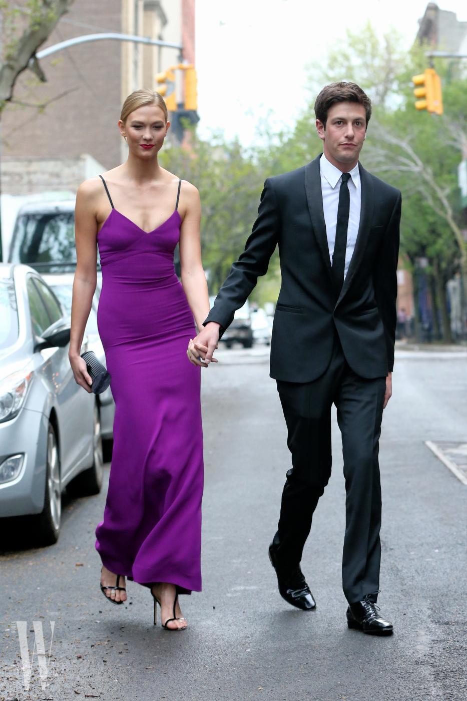 Model Karlie Kloss looks adoringly at boyfriend Joshua Kushner en route to Time 100 Gala