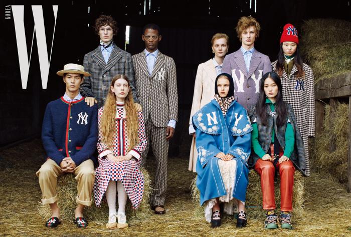 딜런이 착용한 빈티지 체크 울 코트, 스카프, 푸른색 셔츠, 루카스가 착용한 NY 자수 디테일의 재킷과 팬츠, 줄무늬 셔츠, 갈색 모카신, 리나가 착용한 줄무늬 울 재킷과 스커트, 푸른색 셔츠, 귀고리, 혼자가 착용한 포멀 울 재킷과 셔츠, 윤영이 착용한 붉은색 니트 모자, 체크 코트, 스카프, 점프슈트, 현지가 착용한 케이프 재킷, 브로치, 터틀넥 톱, 가죽 팬츠, 크리스털 스트랩 장식의 스니커즈, 사라가 착용한 후드 디테일의 스카프, NY 자수가 돋보이는 오버사이즈 코트, 레이스 드레스, 플랫폼 메리제인 슈즈, 케이가 착용한 격자무늬 울 재킷, 터틀넥 이너웨어, 울 스커트, 레이스 타이츠, 스니커즈, 태은이 착용한 NY 자수와 웹 디테일이 돋보이는 재킷, 줄무늬 셔츠, 사파리 포멀 팬츠, 자수 장식의 가죽 슬라이드는 모두 Gucci 제품.