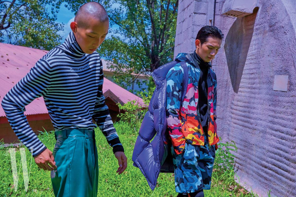 수민이 입은 줄무늬 터틀넥과 초록색 가죽 팬츠는 Givenchy, 박형섭이 입은 검은색 톱, 카무플라주 후디 점퍼와 팬츠는 Valentino, 볼륨감 있는 보라색 패딩은 Z Zegna 제품.