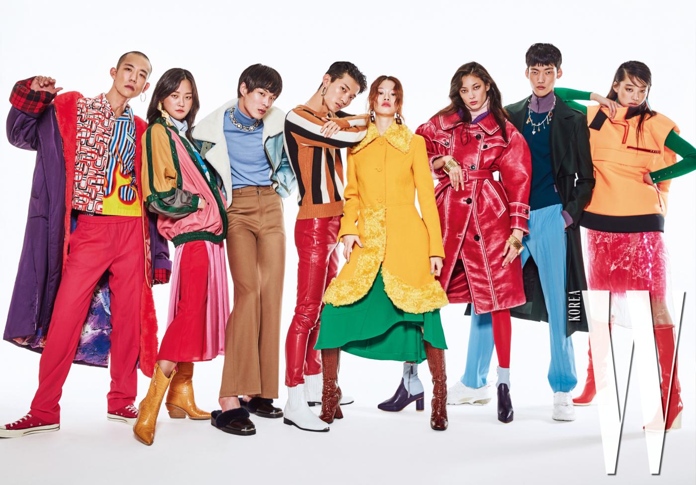 다니엘 오가 입은 코트는 Big Park, 프린트 셔츠는 Prada, 분홍색 팬츠는 Valentino, 스니커즈는 Converse. 이어링은 1064 Studio 제품. 강승현이 입은 스웨이드 재킷과 셔츠는 Gucci, 분홍 스커트는 Eenk, 노란색 부츠는 Fendi, 이어링은 1064 Studio 제품. 박경진이 입은 재킷, 팬츠, 슈즈는 모두 Ordinary People, 터틀넥은 Acne Studios, 주얼 네크리스는 Louis Vuitton 제품. 전준영이 입은 줄무늬 니트는 Sandro, 빨간 팬츠는 Zara, 흰색 첼시 부츠는 Wooyoungmi, 이어링은 Fendi 제품. 김아현이 입은 노란 퍼 코트는 Moschino, 녹색 드레스는 Hugo Boss, 갈색 롱부츠는 Dries Van Noten, 주얼 이어링은 Zara 제품. 티아나가 입은 코트, 니트, 넥워머는 모두 Miu Miu, 앵클 힐은 Dew E Dew E, 골드 뱅글은 Chloe 제품. 정용수가 입은 코트, 트랙 톱, 팬츠는 모두 Valentino, 스니커즈는 Valentino Garavani, 주얼 네크리스는 1064 Studio 제품. 김설희가 입은 패딩 베스트, 오간자 드레스, 시퀸 스커트는 모두 Prada, 녹색 터틀넥은 Hugo Boss, 빨간 부츠는 Stuart Weitzman 제품.