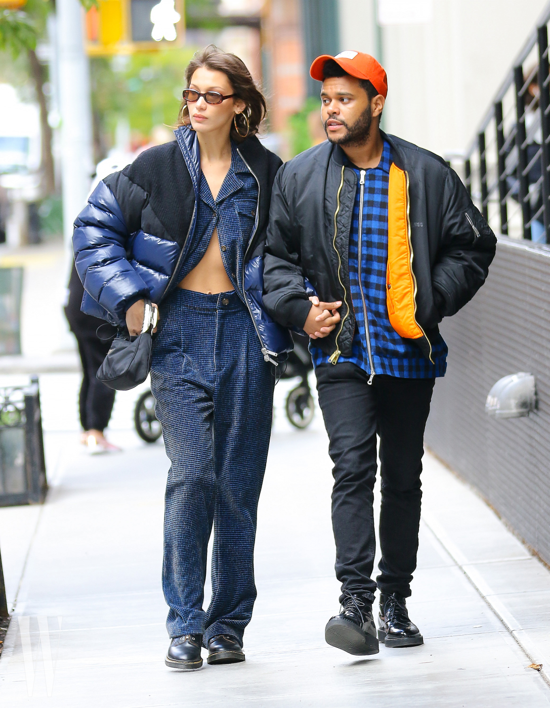Bella Hadid and The Weeknd were spotted taking a romantic stroll around Tribeca Neighborhood.