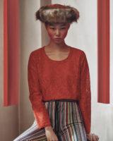빨강 레이스 톱은 Comme des Garcons, 줄무늬 니트 팬츠는 Marques' Almeida by Net-a-Porter 제품.