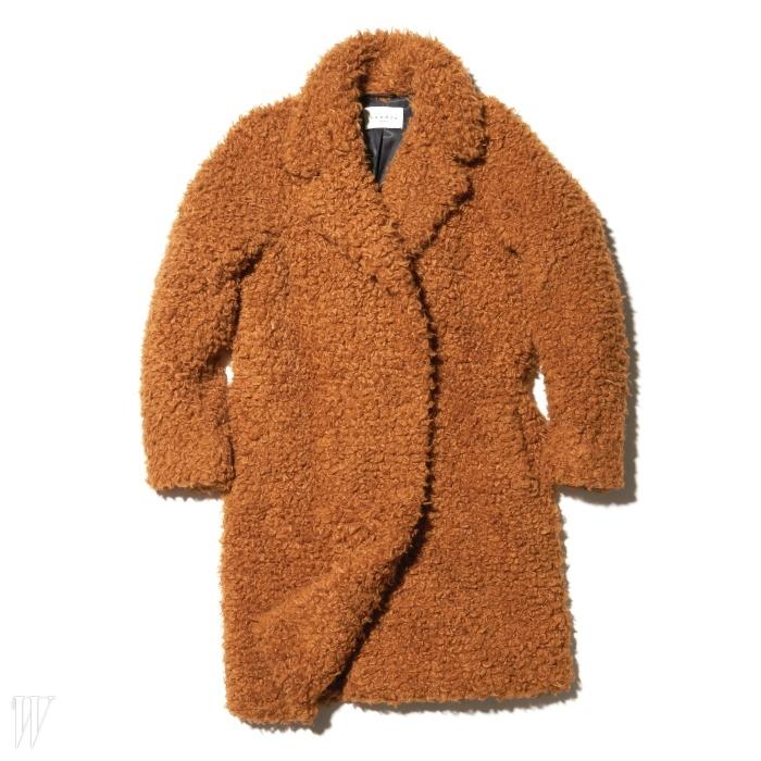 뮤지션 재니스 조플린처럼 보헤미안 분위기를연출하기 딱인 코트는 산드로 제품. 92만9천원.