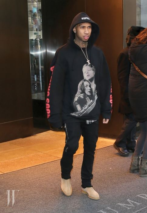Tyga steps out in New York City wearing a black hoodie with an image of Jack and Rose from 'Titanic'. Pictured: Tyga Ref: SPL1226854  130216   Picture by: Splash News Splash News and Pictures Los Angeles:310-821-2666 New York:212-619-2666 London:870-934-2666 photodesk@splashnews.com