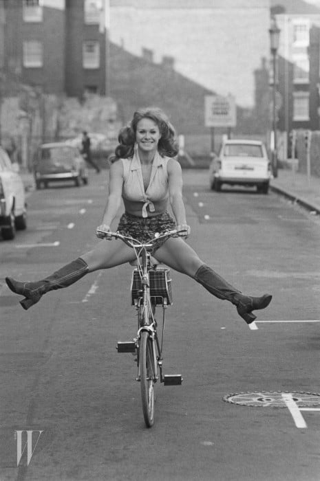 British actress and comedian Carol Cleveland riding a bike, UK, 24th October 1971. (Photo by D. Morrison/Express/Hulton Archive/Getty Images)