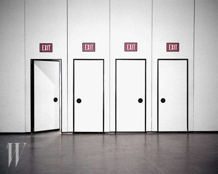 Four exit doors, one open