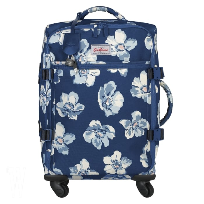 4 하와이로 떠나는 휴가를 상상하게 하는 꽃무늬 기내용 여행 케이스는 캐스 키드슨 제품. 29만8천원.