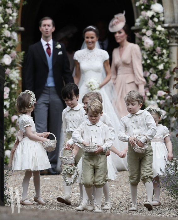 ENGLEFIELD, ENGLAND - MAY 20:  Prince George, center, stands with other flower boys and girls after the wedding of Pippa Middleton and James Matthews at St Mark's Church on May 20, 2017 in Englefield, England.Middleton, the sister of Catherine, Duchess of Cambridge married hedge fund manager James Matthews in a ceremony Saturday where her niece and nephew Prince George and Princess Charlotte was in the wedding party, along with sister Kate and princes Harry and William. (Photo by Kirsty Wigglesworth - Pool/Getty Images)