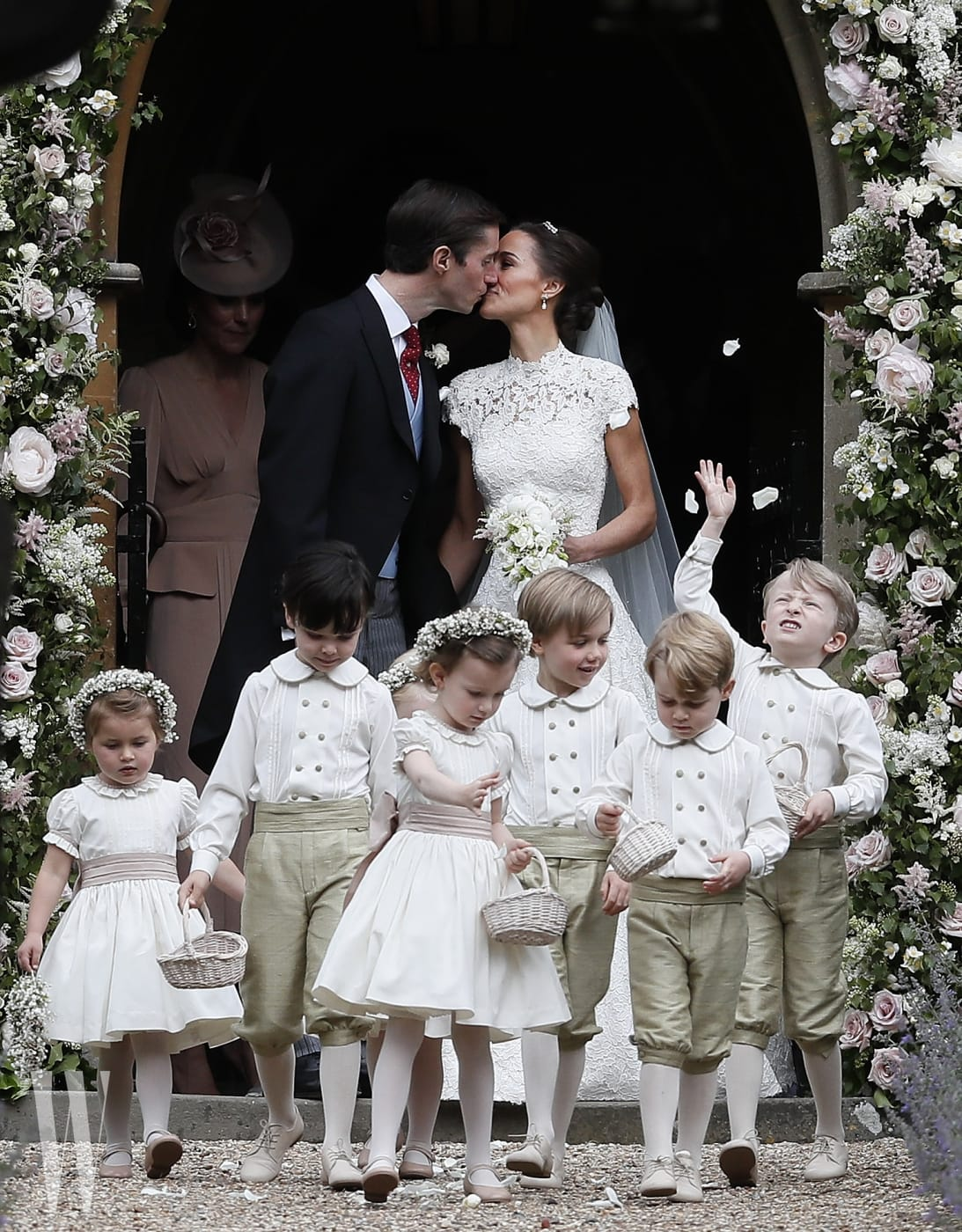 ENGLEFIELD, ENGLAND - MAY 20:  Pippa Middleton and James Matthews kiss after their wedding at St Mark's Church on May 20, 2017 in Englefield, England.Middleton, the sister of Catherine, Duchess of Cambridge married hedge fund manager James Matthews in a ceremony Saturday where her niece and nephew Prince George and Princess Charlotte was in the wedding party, along with sister Kate and princes Harry and William. (Photo by Kirsty Wigglesworth - Pool/Getty Images)