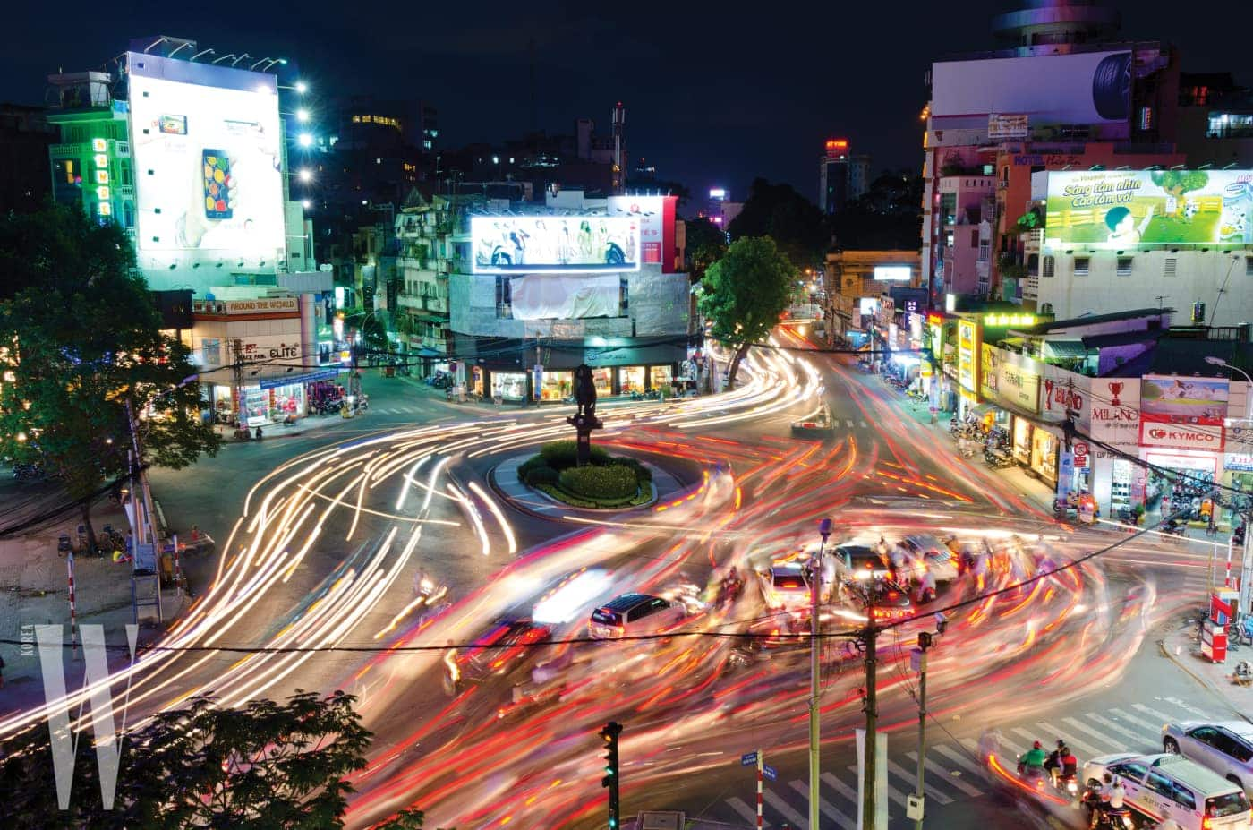 Blured Traffic Moves Around Roundabout, Ho Chi Minh City, Vietnam