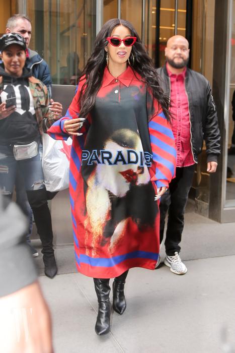 Cardi B seen wearing a long sleeve shirt dress as leaving the SiriusXM Radio Studios in New York City