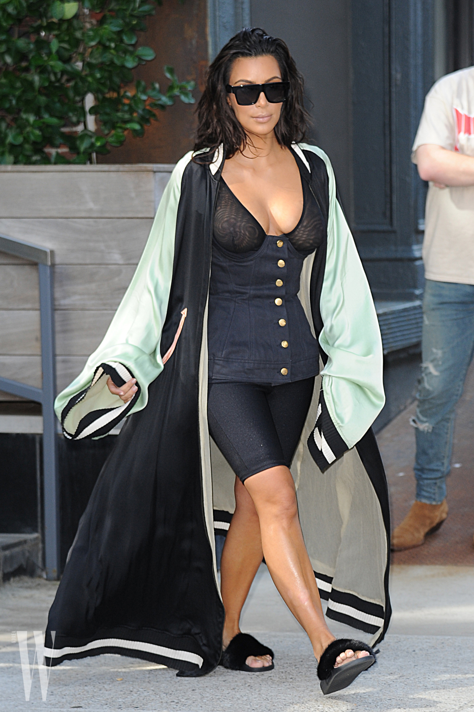 Kim Kardashian West seen leaving a building wearing a see-through bustier corset showing her cleavage while out with Kanye West in New York City on August 30, 2016.
