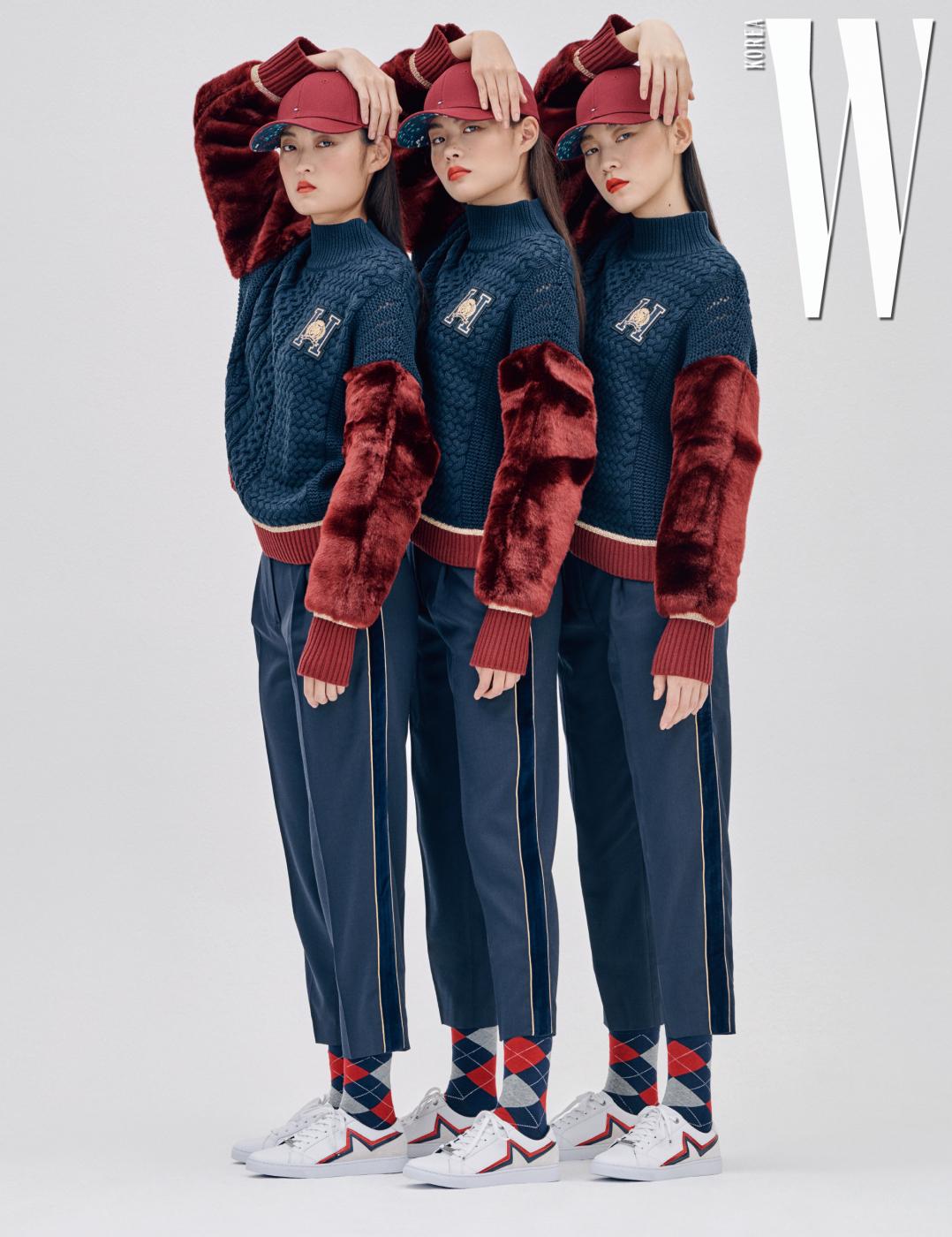 케이블 스웨터, 검정과 골드 줄무늬 팬츠, 스타 아이코닉 스니커즈, 벽돌색 볼캡은 모두 Tommy Hilfiger 제품.