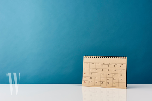 Deadline and message. Calendar on office desk table. With copy space.